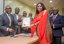 UBA Group Head Human Resources, Mrs Patricia Aderibigbe receiving the Certificate of Accreditation to UBA Academy