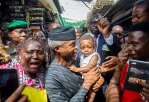 FILE PHOTO: Vice President Yemi Osinbajo interacting with Nigerians