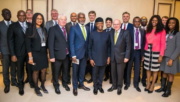Vice President Osinbajo; Nigeria Amb. to Germany, Mr Yusuf Tuggar (L); Ms Yewande Seidu, Executive Sec. Nigeria Promotional Council (NIPC), (extreme right); Federal officials and other Nigeria/German Business delegates
