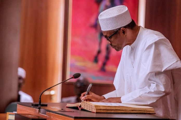 President Muhammadu Buhari signs state legislature and state judiciary financial autonomy into law