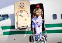President Muhammadu Buhari embarking from an aircraft