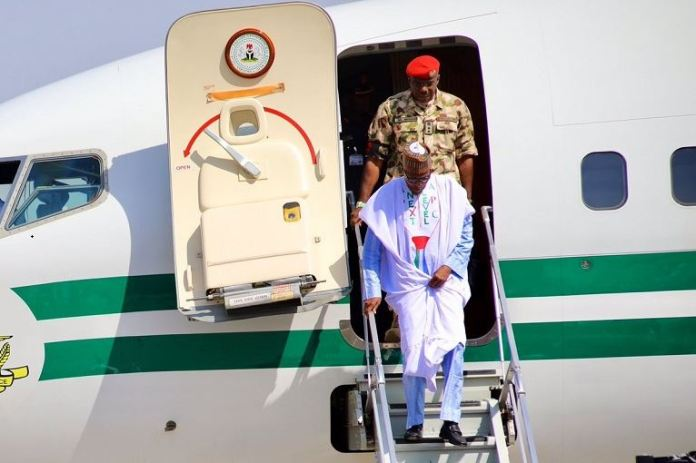 President Muhammadu Buhari embarking from an aircraft