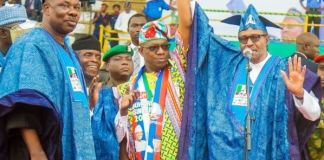 Governor Ibikunle Amosun looks away as President Muhammadu Buhari presents APC governorship candidate, Dapo Abiodun