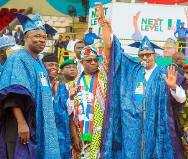 Governor Ibikunle Amosun looks away as President Muhammadu Buhari presents APC governorship candidate, Dapo Abiodun