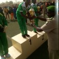 LCpl Naomi Yunana receives the trophy for winning the marathon for Nigerian Army