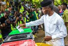 Vice President Yemi Osinbajo casting his vote at the Victoria Garden City