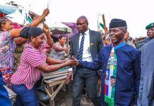 Vice President Yemi Osinbajo walking through a market in Akwa Ibom on Friday