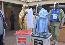 Aisha Buhari holds up her ballot paper in Daura, Katsina State after casting her vote