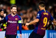 Lionel Messi and Luis Suarez scored late goals as Barcelona beat Atletico Madrid 2-0