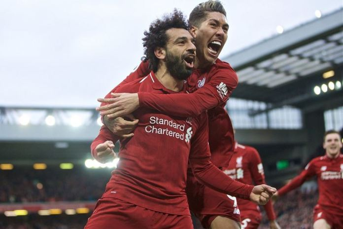 Tottenham scored a late own goal to give Liverpool a 2-1 win at Anfield