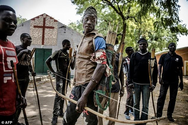 Hunters armed with bows and arrows gathered in Dasso, central Nigeria, in February pledging to defend farmers in conflict with nomadic herdsmen