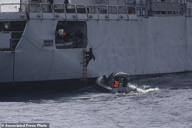 In this photo taken on Wednesday March 20 2019, Nigeria Naval Special Forces board a vessel, during a navy exercise, in the Gulf of Guinea