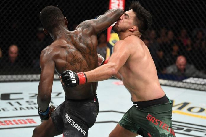 Kelvin Gastelum gets an elbow to the face from Israel Adesanya