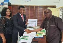 Reps Chike Okafor receiving his Certificate of Return after he was re-elected