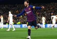 Lionel Messi celebrates after scoring against Granada