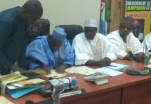 Kano state gov Umar Ganduje signing the bill into law