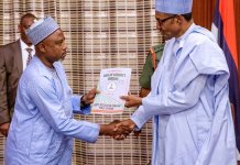 FILE PHOTO: President Muhammadu Buhari receiving his assets declaration form from CCB's Prof. Muhammed Isah