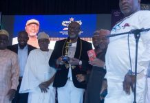 Senator Dino Melaye with his award as Senator of the Year