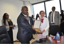 FILE PHOTO: The acting chairman, Ibrahim Magu receiving the application from Noha Amer, Interpol's Project Officer
