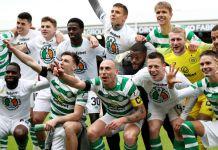 The Celtic team celebrate winning the Scottish Premiership title