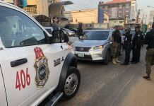 Rapid Response Squad operatives stop a vehicle for driving against traffic