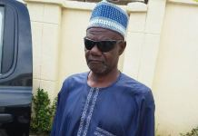 Surety Tijani Adamu has been docked by the EFCC