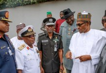 President Buhari with some governors and security chiefs after their meeting at the State House Abuja