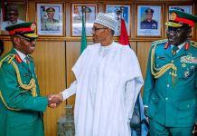 President Muhammadu Buhari flanked by Lt. Gen. Lamidi Adeosun and General Buratai