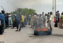 Protesters block a main road in the northern Nigerian city of Maiduguri, demanding the authorities ban a local anti-Boko Haram militia they say is abusing them