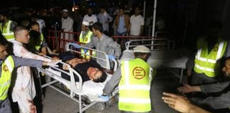 Afghan health workers carried the wounded into hospital
