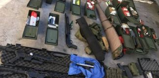 Police seized weapons including an assault rifle
