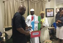 Senator George Akume receiving a certificate from the APC aspirants group from Benue
