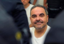 Former president of El Salvador sentenced to two years for bribery