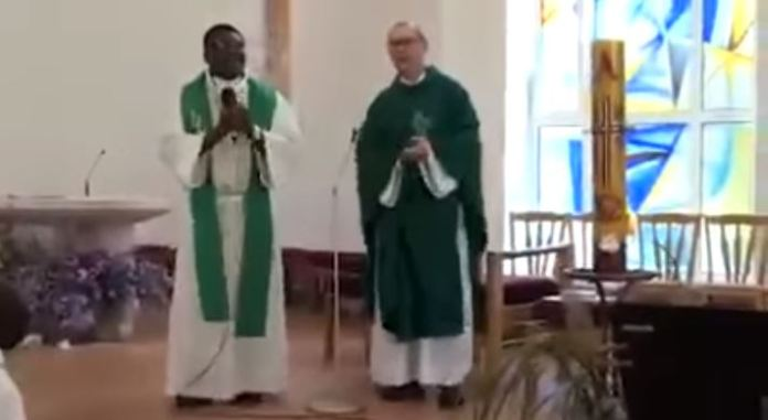 An African minister appears to be teaching the church and the choir Imela, Imela, an Igbo song