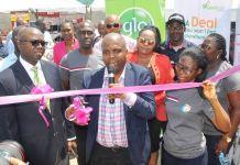 Globacom Representative, Adekunle Adeleke (left), President, Shell Staff Cooperative Investment and Thrift Society Limited, Akinrotimi Akintomide (centre), Globacom Representative, Catherine Onotu (behind) and Business Development Manager, Mary Akwuobi, Shell Cooplag (2nd right), at the opening of the cooperative's trade expo in Lagos on Tuesday