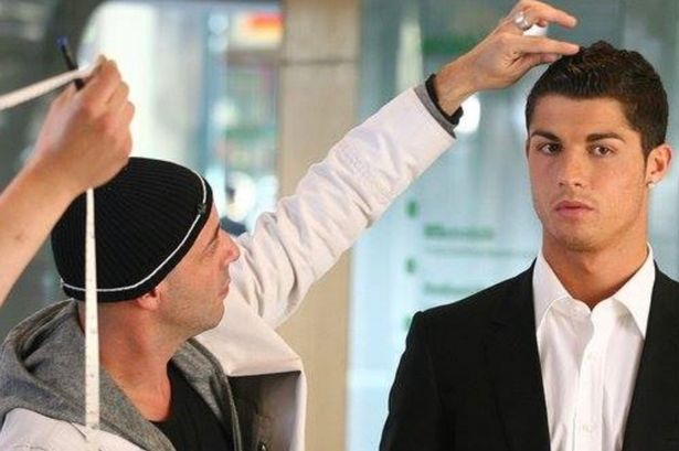 Ricardo Marques Ferreira with Cristiano Ronaldo at a photoshoot