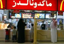 A segregation board separates women and families from men at a McDonalds restaurant in Riyadh