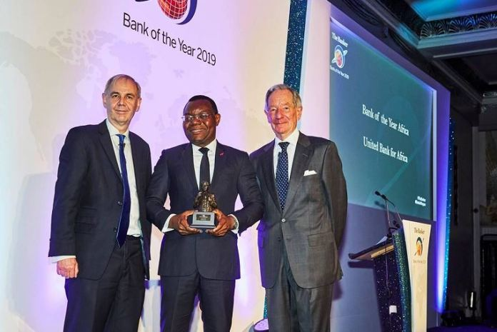 """CEO, UBA Africa, Mr Victor Osadolor (middle) with the """"African Bank of the Year 2019"""" won by United Bank for Africa(UBA) Group at The Bankers Awards held in London."""