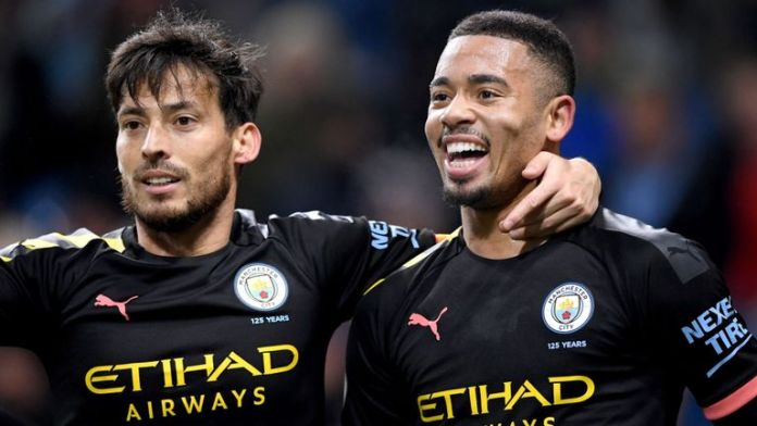 Gabriel Jesus celebrates scoring for Manchester City against Burnley with David Silva