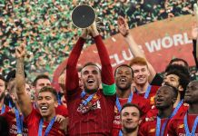 FILE: Liverpool captain Jordan Henderson lifts the Club World Cup trophy