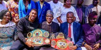 Anthony Joshua presents heavyweight title belts to BuhariAnthony Joshua presents heavyweight title belts to Buhari