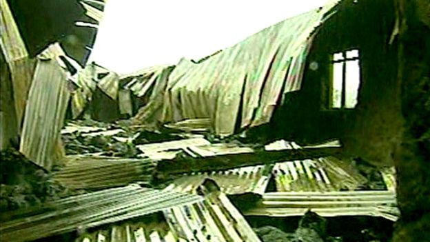 This still from archive footage shows the ruins of the church in the wake of the fire