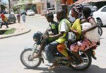 """Uganda Kampala's streets are usually full of """"boda boda"""" motorbike taxis"""