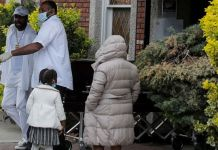 Pallbearers exit a funeral in Brooklyn