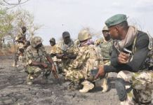 Nigerian troops strategising before executing an attack on bandits