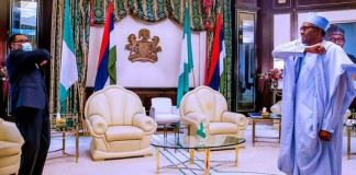 AfDB President Akinwunmi Adesina and President Muhammadu Buhari maintain social distancing during the visit of the former to Aso Rock