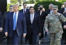 Gen Milley (R) was on the walk with the president, as was Defence Secretary Mark Esper (C)