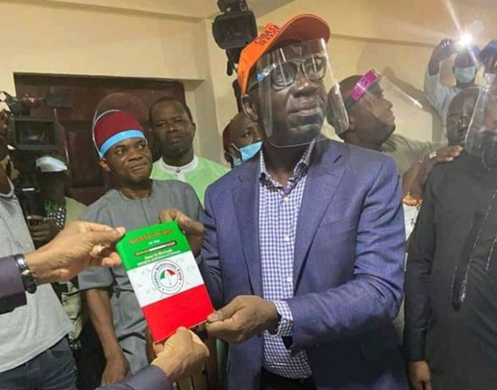 Governor Godwin Obaseki is presented the Peoples Democratic Party membership card