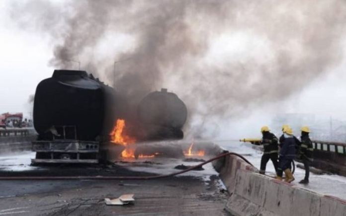 LASEMA operatives putting out the fire from an oil tanker on Lagos-Ibadan Expressway