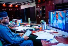 An ecstatic recipient of the 2020 MSMEs Awards celebrates as Vice President Yemi Osinbajo looks on